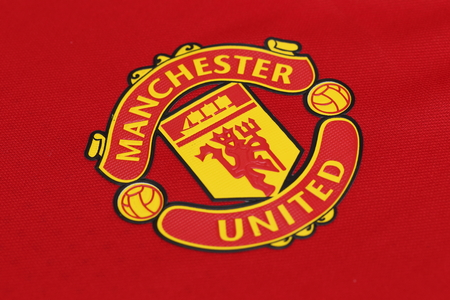 football jersey: BANGKOK, THAILAND - JULY 10, 2016: The  Logo of Manchester United  on Football Jersey on July 10,2016 in Bangkok Thailand. Editorial