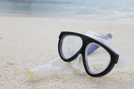 snorkelers: diving mask and a snorkel on the sand Stock Photo