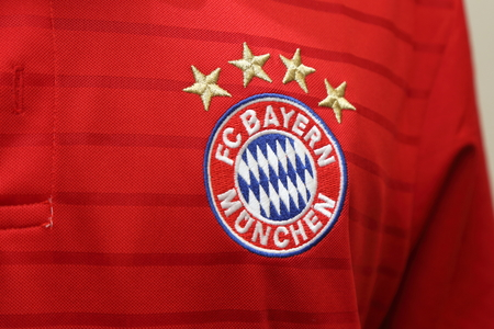 football jersey: BANGKOK, THAILAND - JULY 25, 2016: The Logo of Bayern Munich on Football Jersey on July 25,2016 in Bangkok Thailand.