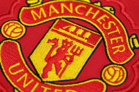 premier: BANGKOK, THAILAND - AUGUST 13, 2016: The Logo of Manchester United on Football Jersey on August 13,2016 in Bangkok Thailand. Editorial