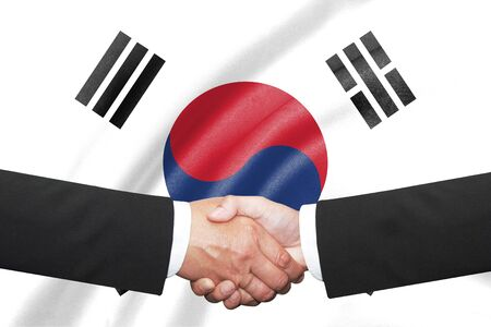syndicate: two businessman handshake over south korea flag