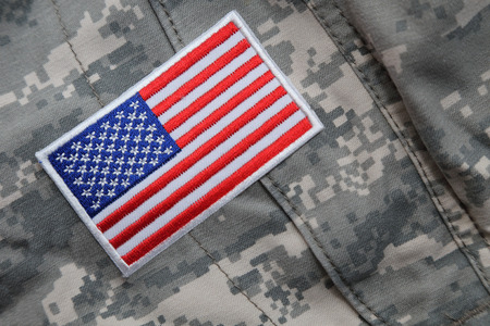 solders: US flag  patch on solders camouflage uniform