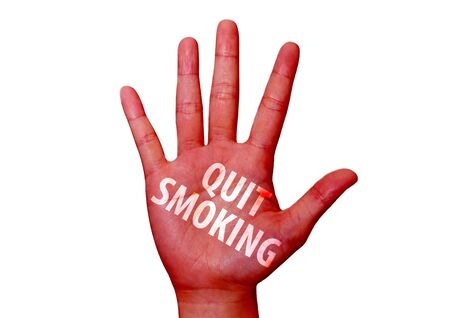 isolated quit smoking written on woman hand