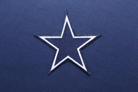 nfl: BANGKOK, THAILAND -SEPTEMBER 14, 2016: The Logo of NFL Dallas Cowboys on the textile on September 14,2016 in Bangkok Thailand. Editorial