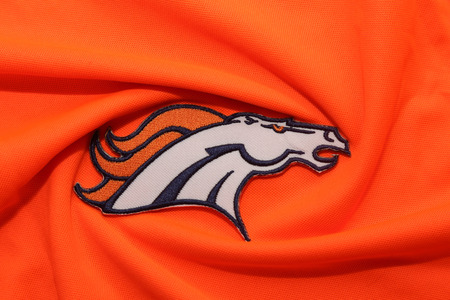 nfl: BANGKOK, THAILAND -SEPTEMBER 25, 2016 Close-Up on Denver Broncos NFL Club Logo on Fabric on September 25,2016 Editorial