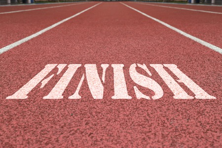 complete crossing: word finish written on the red running track