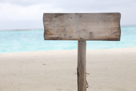 blank wood sign with copyspace on the beach
