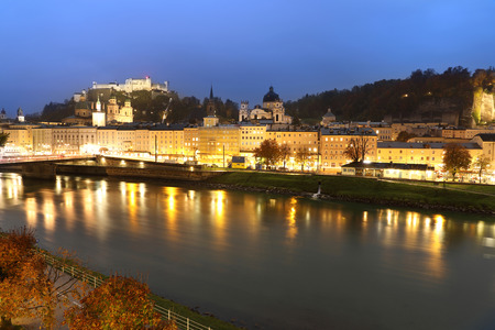wolfgang: view of Salzburg with Festung Hohensalzburg and Salzach river at blue hour Stock Photo