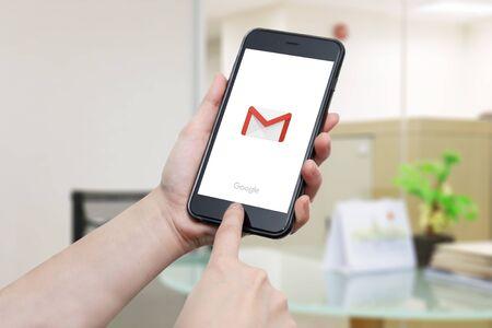 gmail: BANGKOK, THAILAND -NOVEMBER 24, 2016. Gmail app logo display on iphone screen in female hands on November 24,2016  in Thailand.