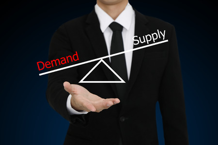 businessman with open hand gesture presenting demand supply diagram