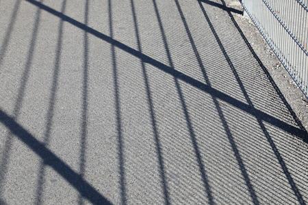 meta: abstract shadow of meta rails on the street