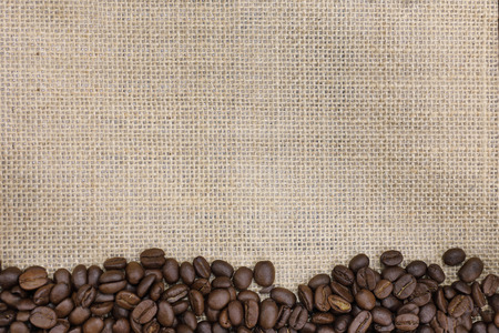 background of roasted coffee bean on a  burlap sack