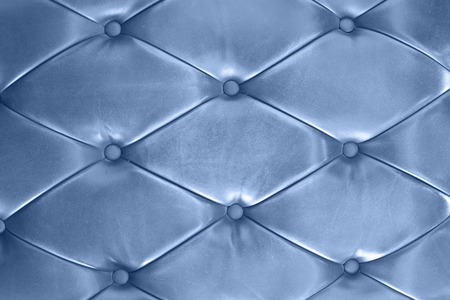 cushioning: classic blue leather texture of a couch with leather buttons Stock Photo