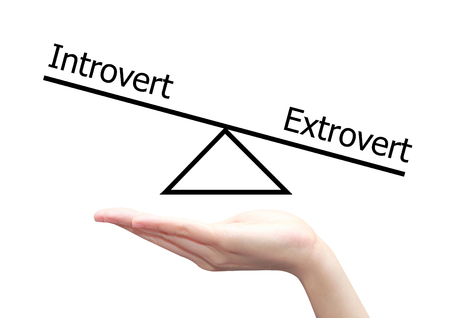 extrovert: isolated hand with introvert and extrovert  concept