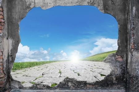 broken brickwall with freedom path