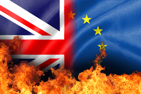 concept of brexit, EU-UK referendum  breaking flags with fire