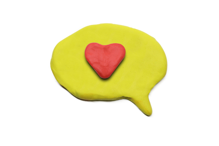 isolated plasticine speech bubble with heart symbol inside