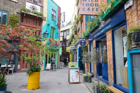 LONDON ,ENGLAND-MAY 5: View of Neals Yard, a small alley in Covent Garden with colorful houses on May 5, 2017