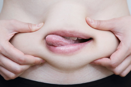 woman grab her belly with her ready to eat mouth
