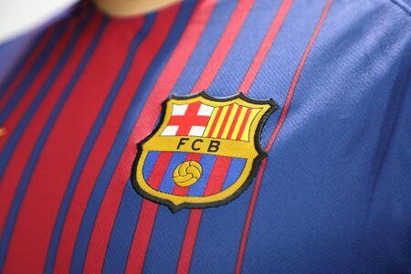BANGKOK, THAILAND -JUNE 26: : the logo of  Barcelona football club on an official jersey on June 26, 2017 in Bangkok Thailand.