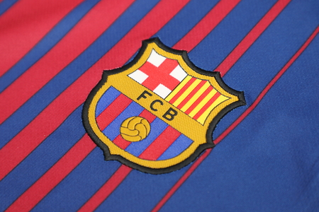 BANGKOK, THAILAND -JUNE 26: : the logo of  Barcelona football club on an official jersey on June 26, 2017 in Bangkok Thailand.