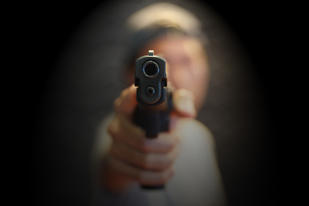 A man hand pointing a gun forward