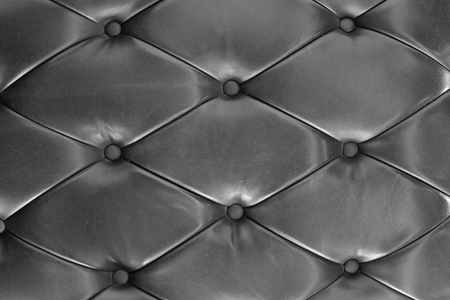 button tufted: background of black leather Sofa Texture
