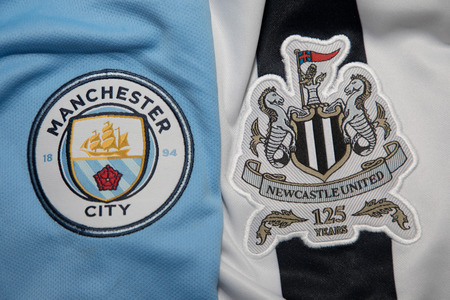 premier: BANGKOK, THAILAND -OCTOBER 19: The Logo of Manchester City  and Newcastle United football club on an official jersey on October 19,2017