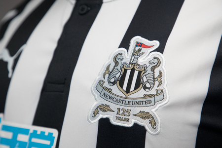 BANGKOK, THAILAND -OCTOBER 18: The Logo of Newcastle United  football club on an official jersey on October 18,2017