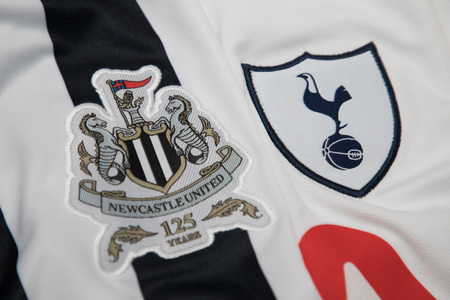 strip shirt: BANGKOK, THAILAND -OCTOBER 19: The Logo of Newcastle United and Tottenham Hotspur  on official jersey on October 19,2017 Editorial