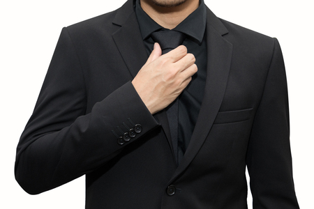 isolated businessman adjusting the neck tie
