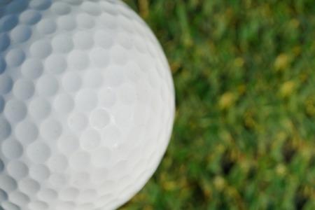 close-up on a golf ball on green grass