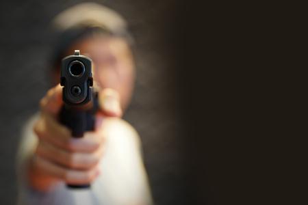 a man hand pointing a gun forward Stockfoto