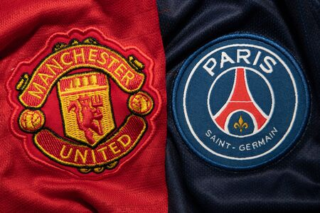 BANGKOK, THAILAND-DECEMBER 18, 2018 : Manchester United and PSG Paris Saint Germain Logo on the Jersey on December 18, 2018. Both of them will face each other in UCL Knockout Round Soon