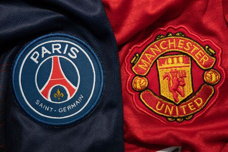 BANGKOK, THAILAND-DECEMBER 18, 2018 : PSG Paris Saint Germain and Manchester United Logo on the Jersey on December 18, 2018. Both of them will face each other in UCL Knockout