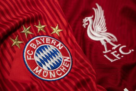 BANGKOK, THAILAND-DECEMBER 18, 2018 : Bayern Munich  and Liverpool Logo on the Jersey on December 18, 2018. Both of them will face each other in UCL Knock