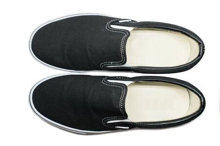 geïsoleerde bovenaanzicht van zwarte slip op schoenen