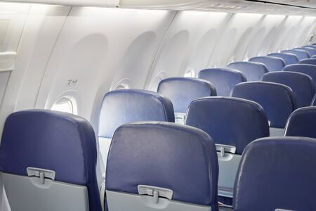empty row of airplane seats Stock Photo