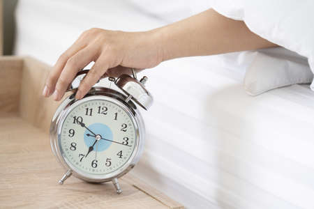 Close-Up on a Man Hand Try to Stop the Alarm of the Clock in the Morning