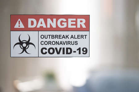 Corona Virus or Covid-19 Warning Signage on the Hospital Mirror Door