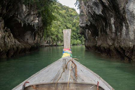 View of Longtail boat Passing Through Hong Island in Krabi Thailand