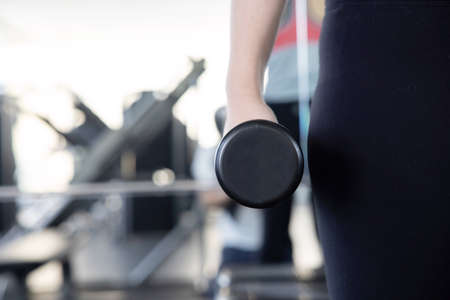 Close-Up on Woman Hand Holding Dumbell for her Exercise