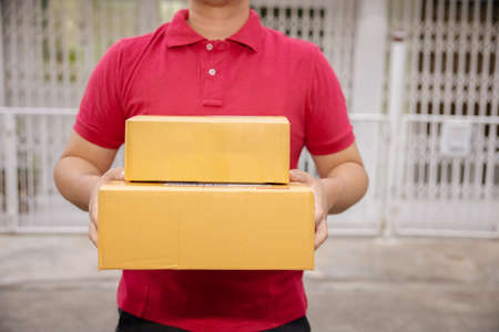 Deliveryman carry a parcel