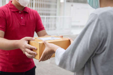 Deliveryman carry a parcel delivering to customer 写真素材