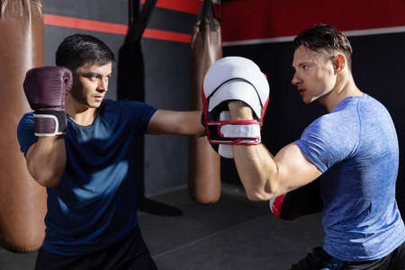 Two Caucasian Boxers Sparring in a Boxing Gym 写真素材