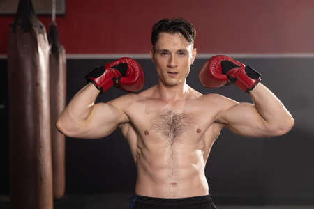 Topless Caucasian Boxer with Red Boxing Gloves Show His Muscle