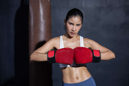 Portrait of Asian Woman with Red Boxing Glove  Ready for Boxing Match