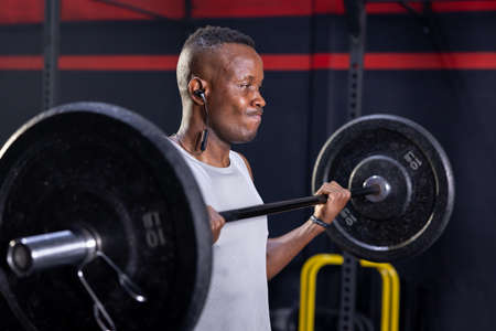 Black African American Man Holding Barbell Ready For Weight Lifting Workout 写真素材