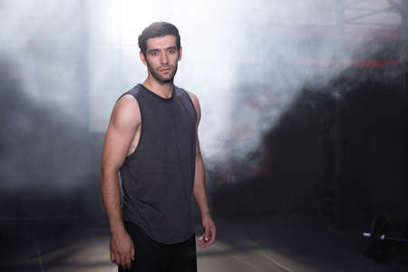 Portrait of Latin Man Standing at aTraining Gym