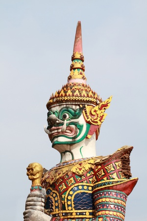 named person: The Thai traditional sculpture style  It is made from cement and decorate with color mirror and colorful painted  Usually in the temple area